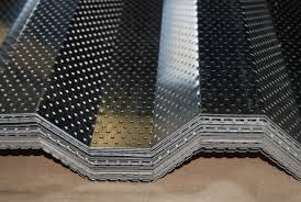 perforated metal roof deck on small dining table on extendable glass dining table