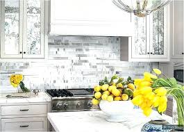 light gray subway tile backsplash light gray cabinets and island white solid surface subway tile wood