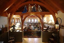 The Hobbit  Real life Shire house built by Tolkein fan in    Creature comforts  The interior houses rare Tolkein memorabilia  including statues  books  and