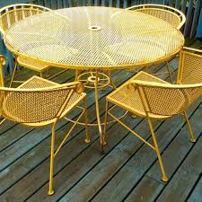 how to paint wrought iron furniture paint your wrought iron patio furniture have an entire set table 4 chairs umbrella stand bench rocker side chair just