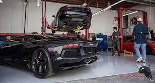 two exotic cars in raging bull performance repair bay