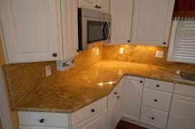 maple cabinets and kashmir gold granite