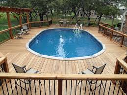 Above ground pools decks idea bing images the pics show great ideas if you can stand the extra crap they show between each one