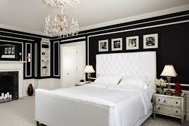 black and white bedroom chandelier white bed with white tufted headboard elegant nightstands black wall white