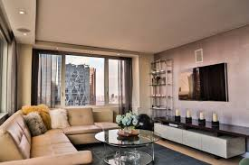 contemporary media console furniture. midsized trendy open concept light wood floor family room photo in new york with contemporary media console furniture