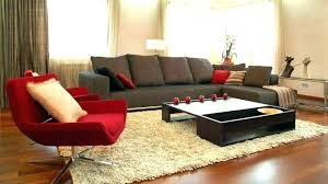 what color rug goes with a brown couch brown and red curtains for living room living
