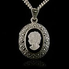 locket pendant empress carlota made of solid sterling silver 925 beautifully decorated with a mother of pearl cameo on a natural black onyx stone and