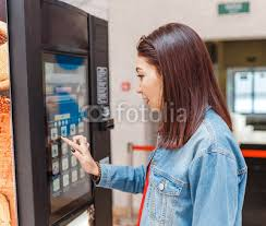 Vending Machine Buyers Classy Woman Buying Coffee From Automatic Vending Machine Buy Photos AP