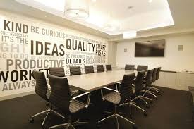 office meeting room design. Interior:Elegant Office Meeting Room With Wall Decor Also Padded Back Swivel Chairs Around Solid Design G