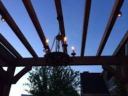hanging chandeliers in outdoor living areas brings comfort charm and a touch of elegance