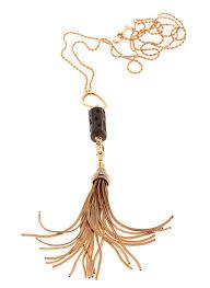 selim mouzannar a gold tassel on a long chain