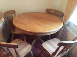 solid pine round table with 4 chairs does need attention