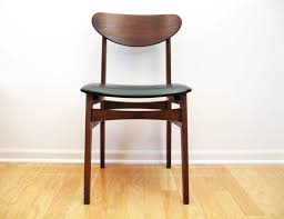 inexpensive mid century modern furniture. Furniture. Brown Wooden Desk Chair With Curved Back Rest On Floor As  Well Inexpensive Mid Century Modern Furniture