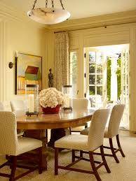 centerpiece ideas with chandelier and round dining table also rug plus contemporary dining chairs with wall pictures and statue at the corner also