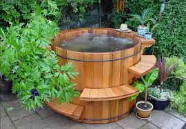 corner cedar hot tub and curved wooden steps mixed with small flower vase on curved