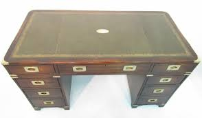 a stylish military campaign desk a very well made solid gany desk by cabinet makers bevan funell dating from the mid 2o th century the drawers