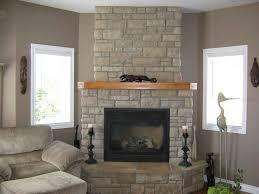 calming living room design with brick stone black iron frame corner fireplace with wood shelf