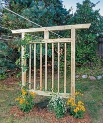Small Picture Homemade Clothesline that is also a Garden Trellis DIY Project