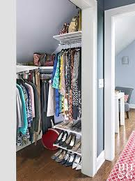 don t let slanted ceilings deter your plans for a highly functioning small walk in wardrobe this design makes the most of a closet s wall space
