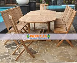 teak oval double extending table and 12 pieces foldable chairs