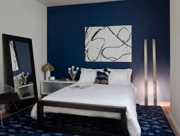 white and black abstract painting for small bedroom decorating ideas with navy blue accent wall color