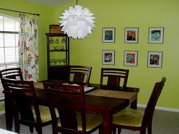 elegant green vinyl upholstered dining chairs mixed with round dining table and