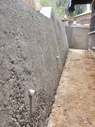 reinforce the front of the wall this can be done by forming or pneumatically placing concrete to thicken the base and tapering to a height where the added