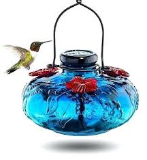 hand blown glass hummingbird feeder home decor an intricate and unique artisan national geographic