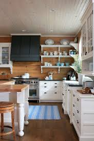 blue striped fabric rug white lacquered wood kitchen cabinet brown wooden kitchen backsplash black metal wall