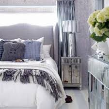 bedroom with mirrored furniture. mirrored furniture u0026 menswear pillows in blue bedroom with p