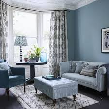 glamorous grey living room filled with patterned fabrics