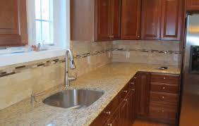travertine subway tile kitchen backsplash with a mosaic glass tile border you