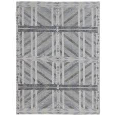 large modern scandinavian swedish geometric rug in gray and pastel colors for