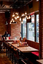 lighting for restaurant. restaurant interior brick walls light bulbs rustic lighting for