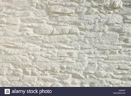 painted stone wallWhite painted stone wall Wales UK KATHY DEWITT Stock Photo