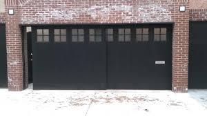 Black Side Sliding Garage Doors On Bricked Wall House Side Sliding ...