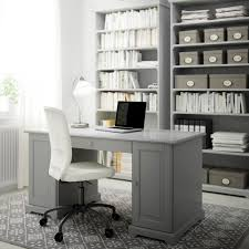 office furniture at ikea. a home office with grey desk bookcases and swivel chair white cotton furniture at ikea