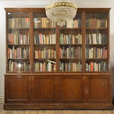 A large poplar and glazed bookcase,
