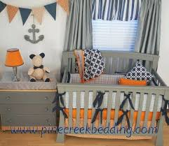 navy blue and gray nursery ideas navy orange and grey crib bedding in a nautical nursery