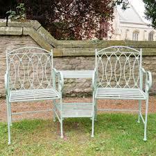 rustic green metal bench