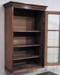 antique oak wall hanging cabinet