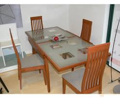 expandable glass dining table and wood chairs