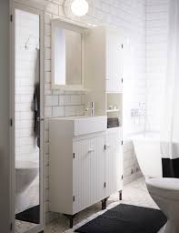 white bathroom cabinets. a white bathroom with narrow wash-basin cabinet, high cabinet and mirror cabinets