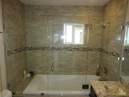 bathroom white bath tub combined with large glass door plus silver steel handler on the