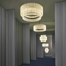 created by italian brand poltrona frau the lights incorporates two diffe types of blown glass held together by leather bands