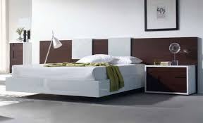 View in gallery Modern floating bed in a soothing setting