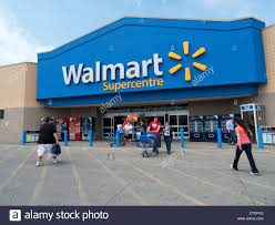 walmart store entrance. Plain Walmart Exterior View Of Walmart Supercentre Store And People With Shopping Trolley  At The Entrance On Entrance T