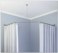 curved iron mountain curtain rods with linen curtains ideas