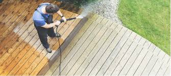 patio or decking with a pressure washer