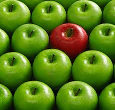 green and red apples in basket. red apple in basket of green apples and